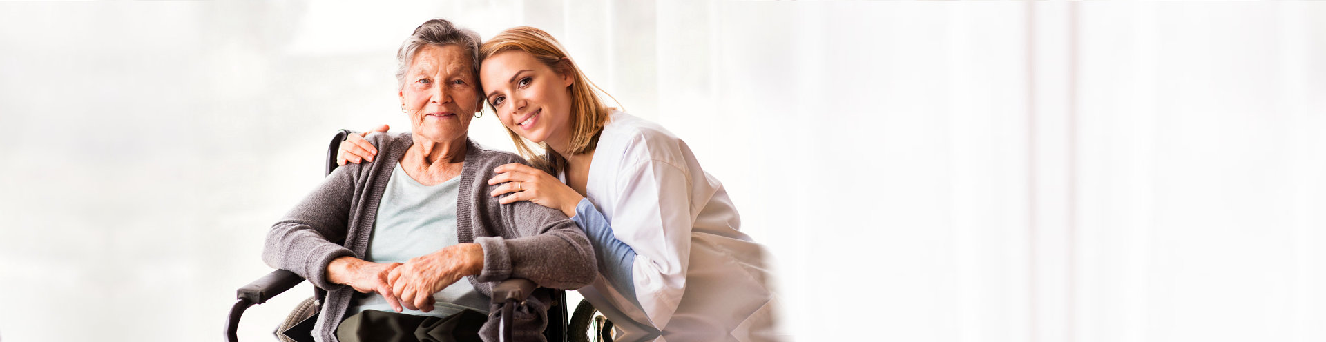 caregiver and patient both smiling